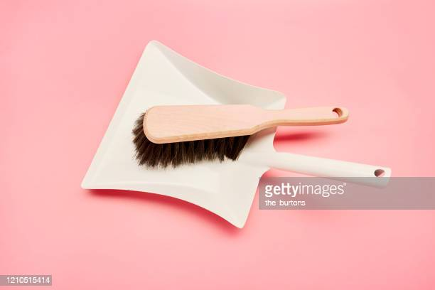 high angle view of dustpan and broom on pink background - 箒 ストックフォトと画像