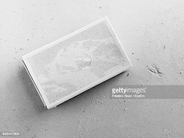 High Angle View Of Dusty Matchbox On Table