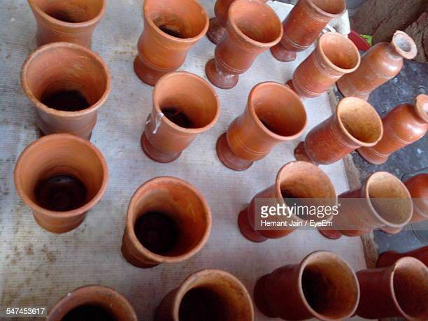 High Angle View Of Earthen Glasses Arranged On Table At Shop
