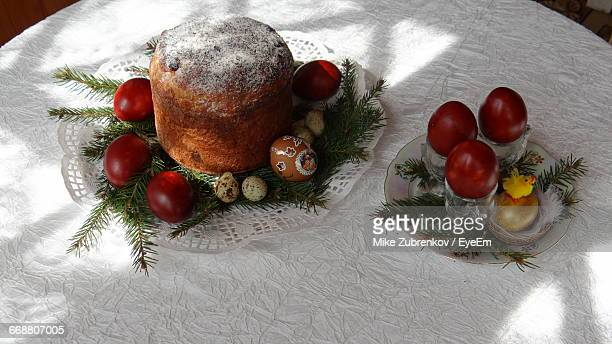 high angle view of easter cake and eggs on table - happy easter in russian stock pictures, royalty-free photos & images