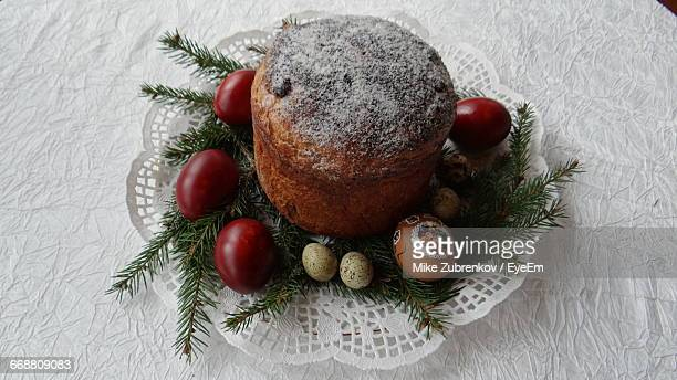 High Angle View Of Easter Cake And Eggs On Table
