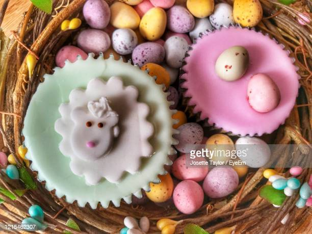 high angle view of  easter cupcakes on table - easter stock pictures, royalty-free photos & images