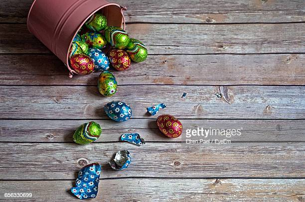 High Angle View Of Easter Eggs On Wooden Table