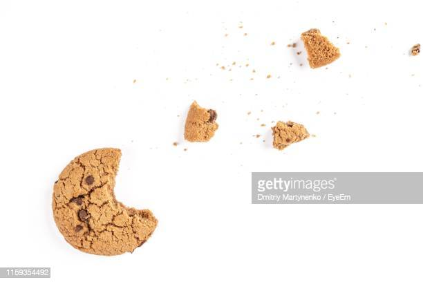high angle view of eaten cookie over white background - チョコレートチップクッキー ストックフォトと画像