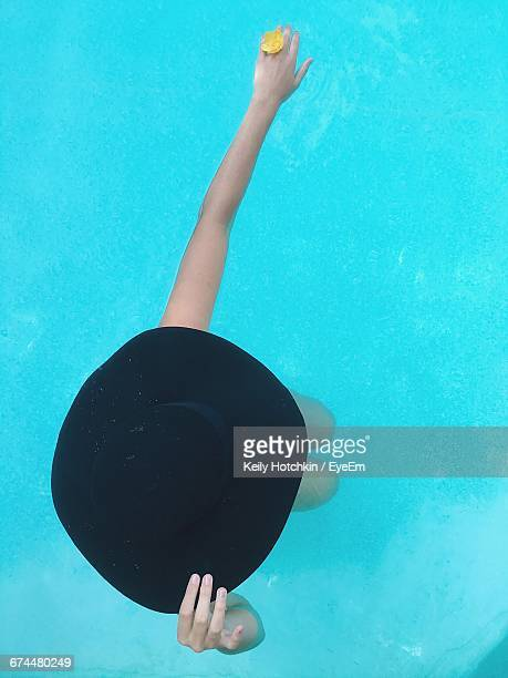 high angle view of eccentric woman in swimming pool - diva human role stock photos and pictures
