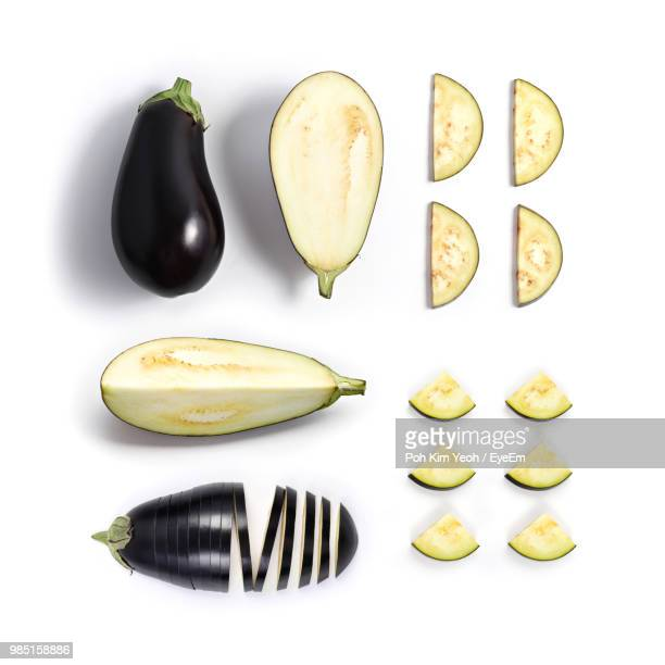 high angle view of eggplants over white background - eggplant stock photos and pictures