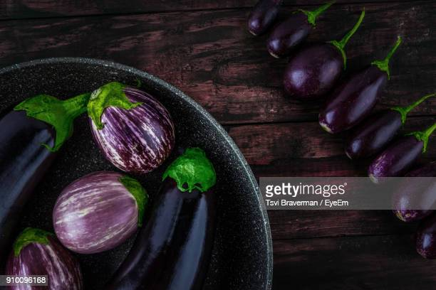 high angle view of eggplants with frying pan on table - eggplant stock photos and pictures