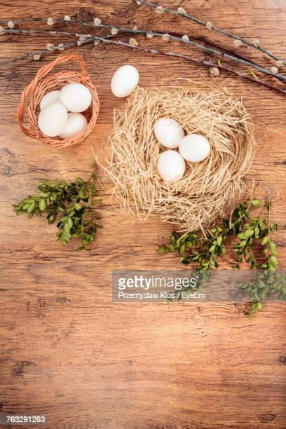 High Angle View Of Eggs And Herbs On Wooden Table