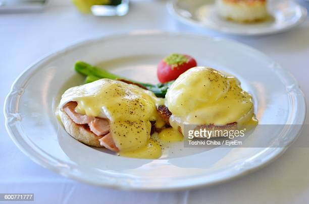 High Angle View Of Eggs Benedict Served In Plate On Table