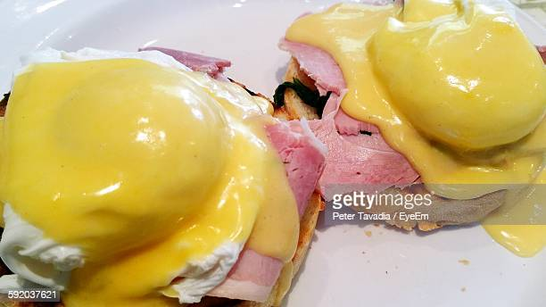 High Angle View Of Eggs Benedict Served In Plate