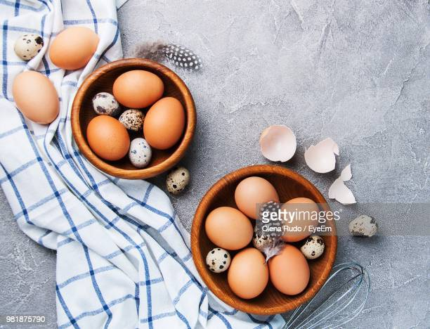 High Angle View Of Eggs In Bowls On Table