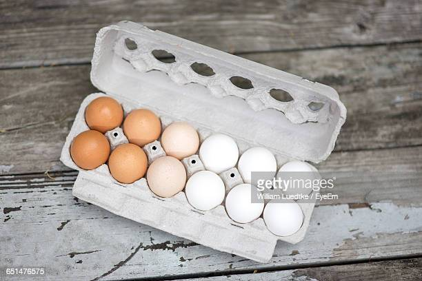 High Angle View Of Eggs In Carton On Table