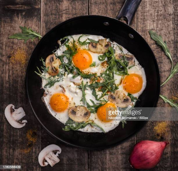 high angle view of eggs in pan on table, warszawa, mazowieckie, poland - warsaw stock pictures, royalty-free photos & images