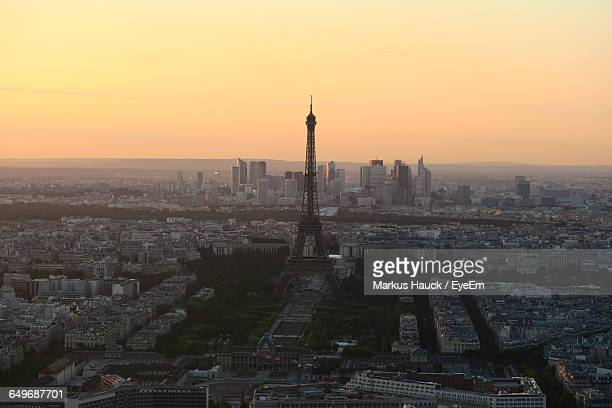 High Angle View Of Eiffel Tower In City During Sunset