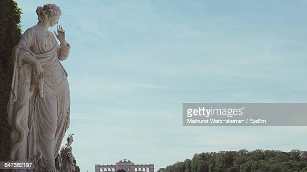high angle view of elegant statue against cloudy sky - classical greek style stock pictures, royalty-free photos & images
