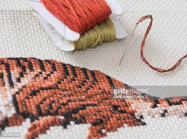 high angle view of embroidery work on fabric - embroidery stock pictures, royalty-free photos & images