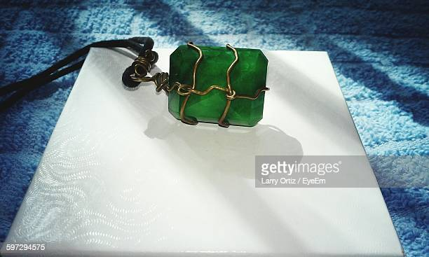 High Angle View Of Emerald Necklace On Table At Home