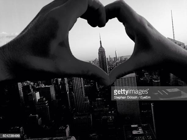 High Angle View of Empire State Building Seen Through Heart Shape Made By Hand