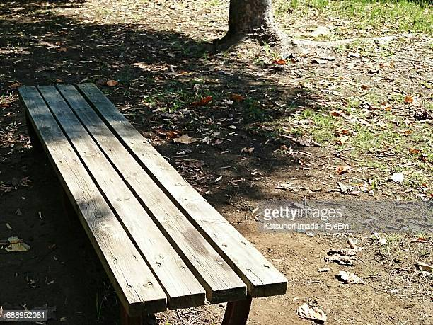 High Angle View Of Empty Bench On Field