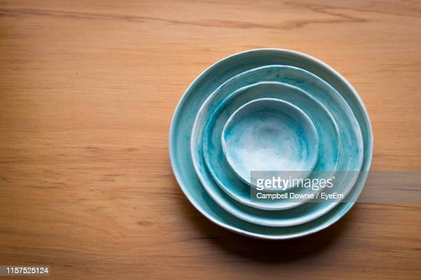 high angle view of empty bowls on wooden table - campbell downie stock pictures, royalty-free photos & images