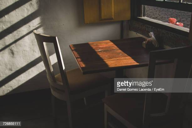 High Angle View Of Empty Chair And Table By Window At Home