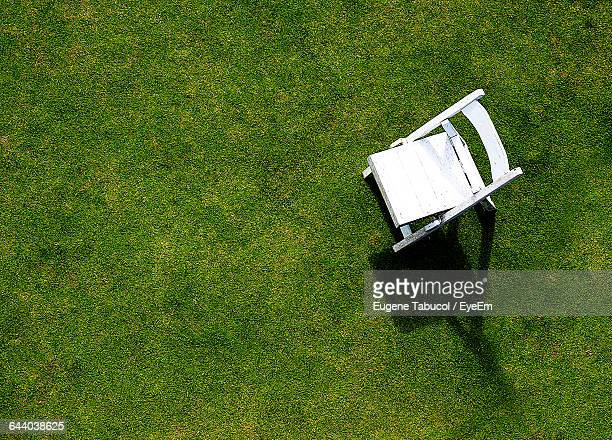 High Angle View Of Empty Chair In Lawn