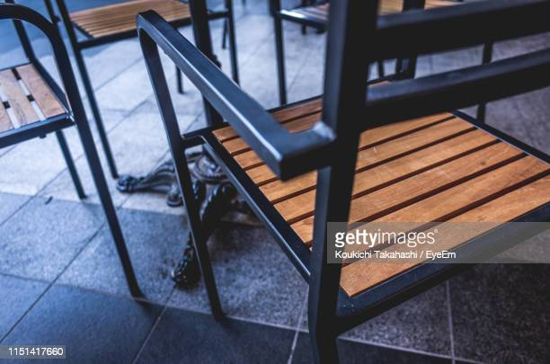 High Angle View Of Empty Chairs And Table In Cafe