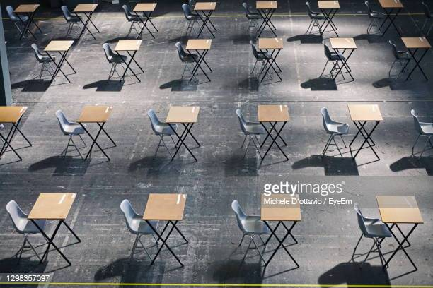high angle view of empty chairs and table in cafe - college admission stock pictures, royalty-free photos & images