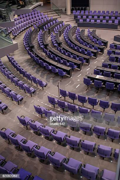 high angle view of empty chairs in german parliament hall - politics stock-fotos und bilder