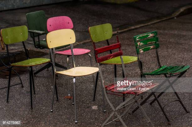 High Angle View Of Empty Chairs On Road