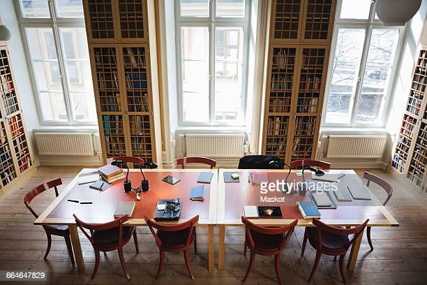 High angle view of empty chairs with table in board room at law library