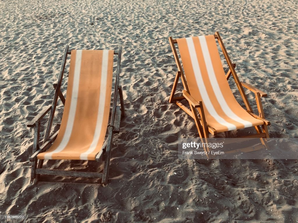 High Angle View Of Empty Lounge Chairs At Beach : Stock-Foto