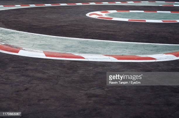 high angle view of empty motor racing track - motor racing track stock pictures, royalty-free photos & images