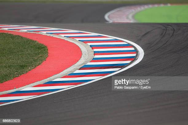 high angle view of empty motor racing track - motor racing track stock photos and pictures