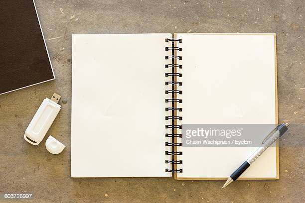 High Angle View Of Empty Note Pad On Table