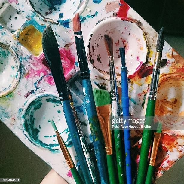 High Angle View Of Empty Palette And Paintbrushes On Table