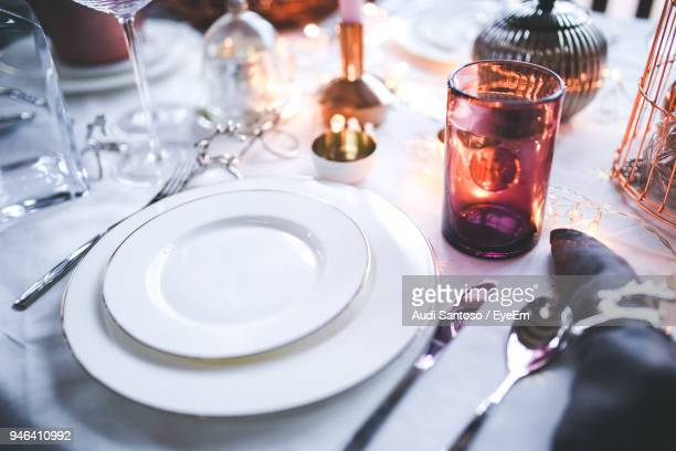 high angle view of empty plates on dining table - place setting stock pictures, royalty-free photos & images