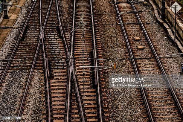 high angle view of empty railroad tracks - railroad track stock pictures, royalty-free photos & images