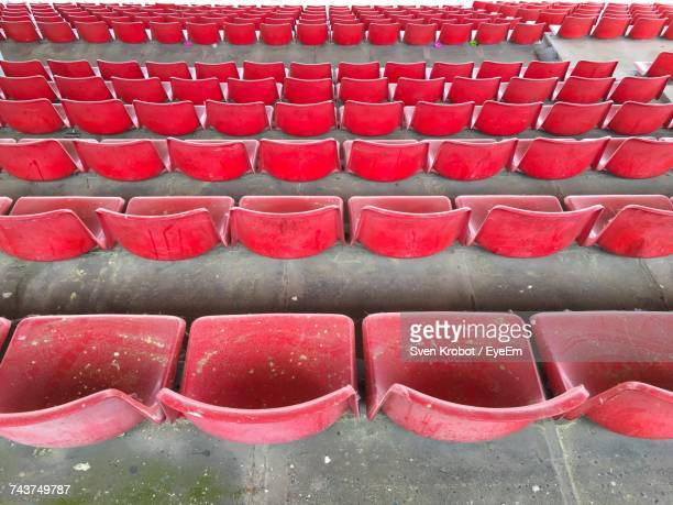 High Angle View Of Empty Red Chairs At Stadium