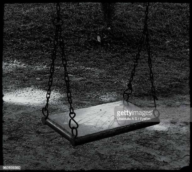high angle view of empty swing at park - thiruvananthapuram stock photos and pictures