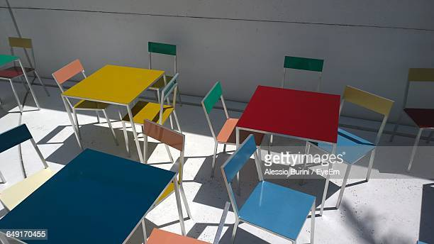 High Angle View Of Empty Tables And Chairs At Cafe