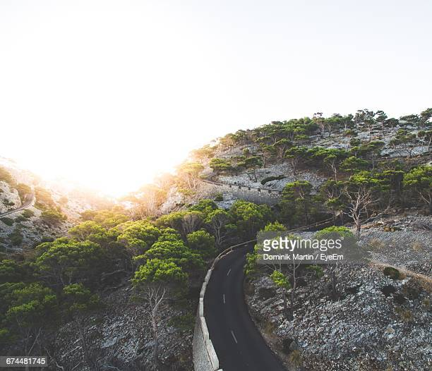 High Angle View Of Empty Winding Road With Copy Space