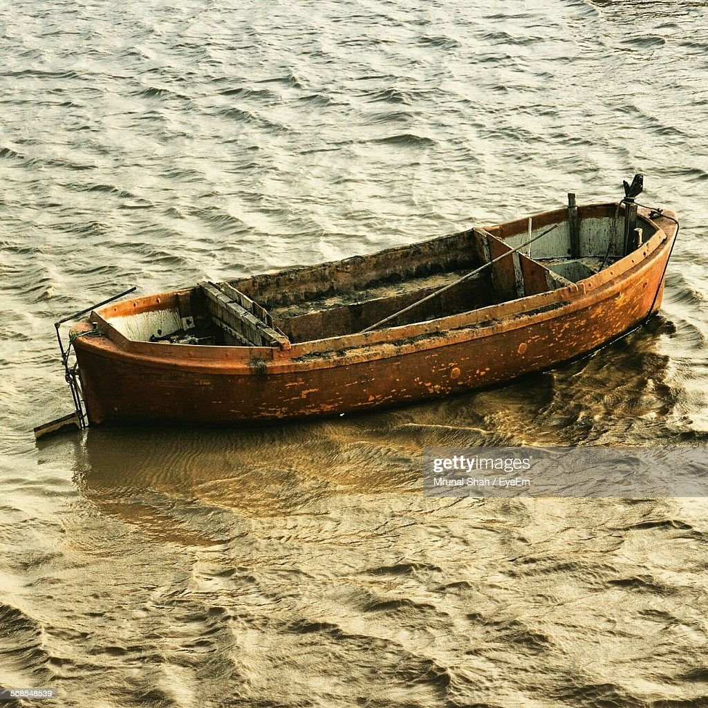 High Angle View Of Empty Wooden Boat Moored On River : Stock Photo