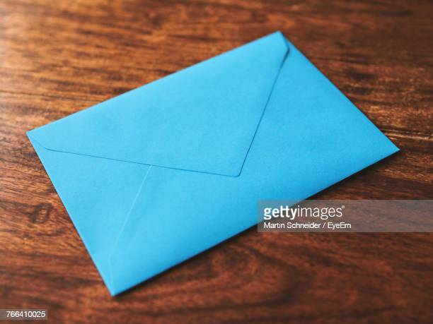 High Angle View Of Envelop On Table