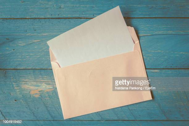 high angle view of envelope on table - envelope stock pictures, royalty-free photos & images