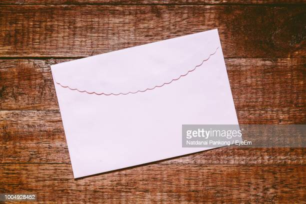 High Angle View Of Envelope On Table