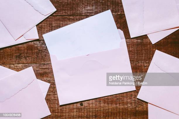 High Angle View Of Envelopes On Table