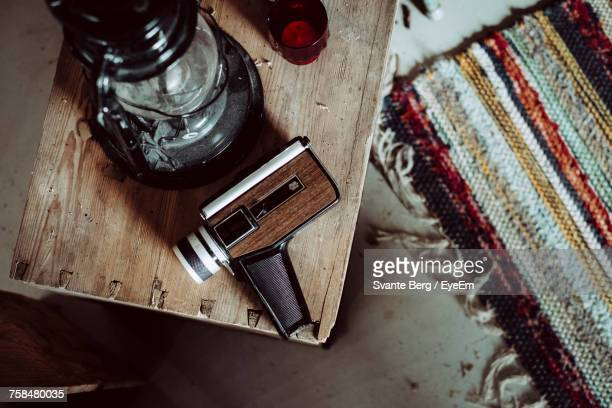 High Angle View Of Equipment By Oil Lamp On Wooden Table