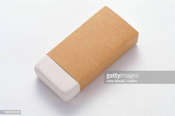 high angle view of eraser against white background - eraser stock pictures, royalty-free photos & images