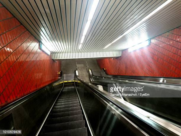 High Angle View Of Escalators In Illuminated Subway Station